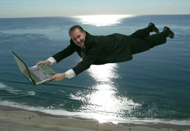 Man Flying with Computer